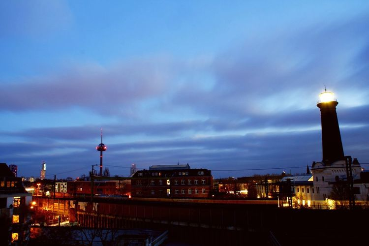 Cologne EyeEm Selects View From Above Streetphotography Car Tourism City Cityscape Illuminated Urban Skyline Ferris Wheel Winter Sunset Sky Architecture Building Exterior Lighthouse Railroad Station Platform Clock Tower Street Light Office Building Railroad Track Direction Skyscraper #urbanana: The Urban Playground