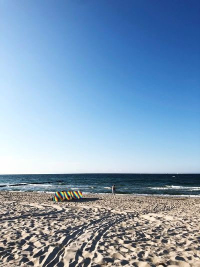 Strand in Warnemünde bei Rostock Sea Beach Horizon Blue Day Sunlight Outdoors Nature Sand Copy Space Non-urban Scene Beauty In Nature