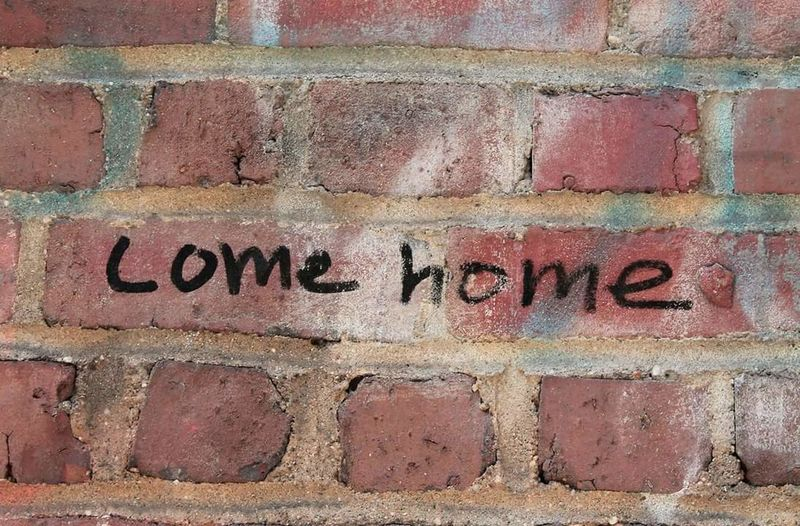 """""""Come home"""" Red Brick Bricks Wall Writing Writing On The Walls New York Chelsea USA USAtrip EyeEm EyeEm Best Shots EyeEm Selects EyeEmBestPics EOS Canon Canonphotography Canon_photos Text Western Script Communication Full Frame Day No People Textured  Backgrounds Close-up Built Structure Architecture Outdoors"""