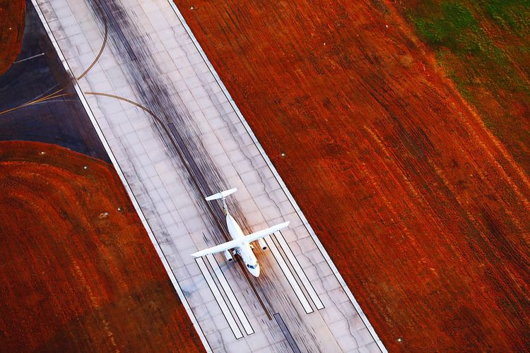 Aerial View Of Airplane On Runway