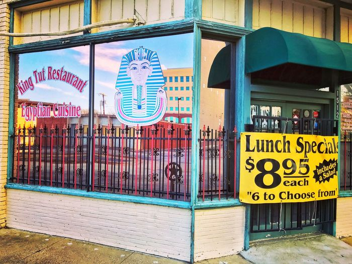 Lunch Specials at the King Tut Signage Reflections Ft Worth, TX Storefront Egyptian Cuisine City Life Text Communication Architecture Building Exterior Built Structure Outdoors Day No People Multi Colored City