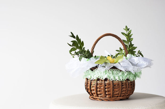 Wicker Easter basket Arts And Crafts Basket Close-up Copy Space Day Easter Easter Basket  Easter Cards Easter Egg Easter Eggs Easter Ready Flower Flower Head Freshness Indoors  Nature No People Postcard Postcards Studio Shot Whicker White Background Wicker Wicker Basket Wickerwork