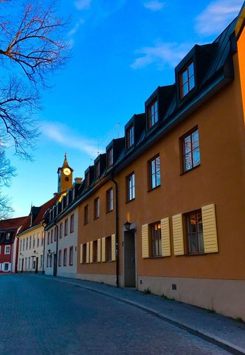 View of residential buildings against sky