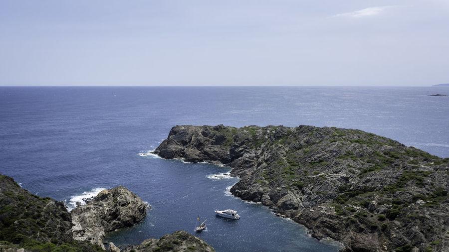 Scenic view of cap de creus against sky