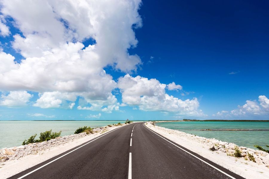 The causeway between North Caicos and Middle Caicos in the Turks And Caicos islands. EyeEm Selects EyeEm New Here Sea Sky Scenics Water The Way Forward Road Tranquil Scene Blue Outdoors Horizon Over Water Tranquility Cloud - Sky No People