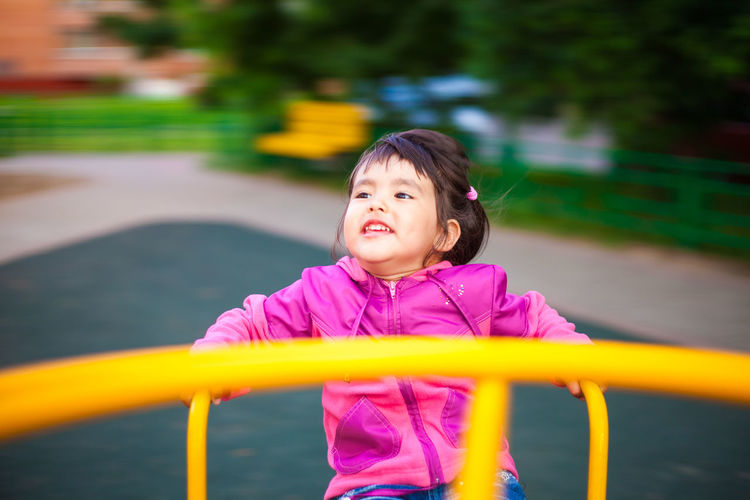 Portrait of happy girl playing in park