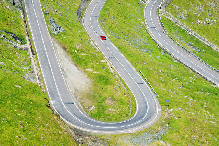 High angle view of red car on winding country road