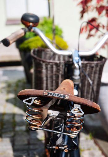 Close-up of bicycle hanging on metal