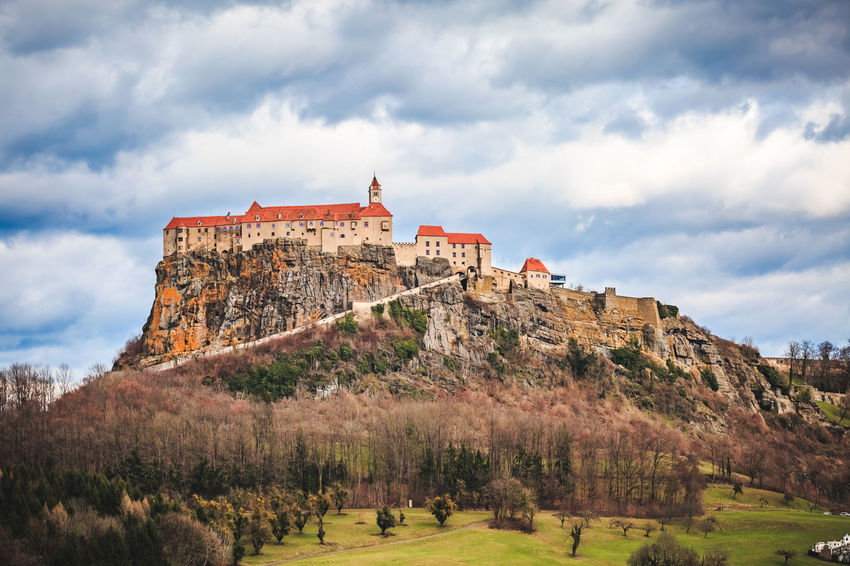 Burg Riegersburg Austria Styria Steiermark Architecture Beauty In Nature Building Building Exterior Built Structure Cloud - Sky Clouds And Sky Day Environment Grass History Land Mountain Nature Outdoors Plant Scenics - Nature Sky The Past Travel Travel Destinations Tree