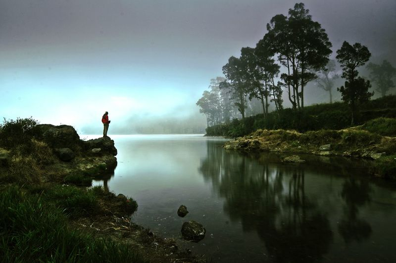 Lake Water Reflection Nature Beauty In Nature Tree Fog Full Length Landscape Sky Outdoors People One Person Travel Destinations Tranquility Adventure Adult Mountain Adults Only One Man Only