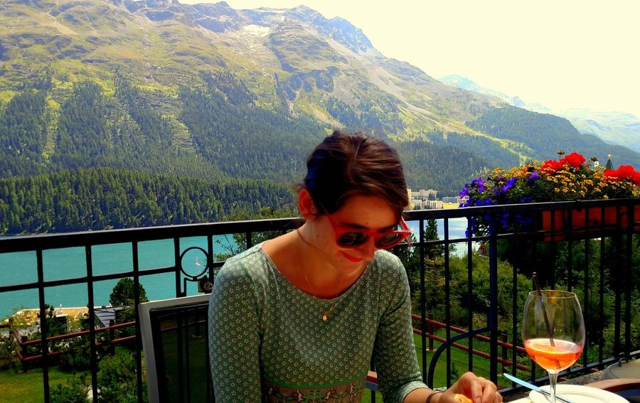 Young Woman on Terrace in St.Moritz Lifestyles One Person Real People Young Adult Railing Outdoors Nature Switzerland St Moritz Day Tree Water Sky lake Alps Switzerland Alps Landscape Close-up Portrait Of A Woman Portrait terrace Outdoor Lunch Al Fresco Dining travel Traveling Solo Traveler beauty Beautiful World