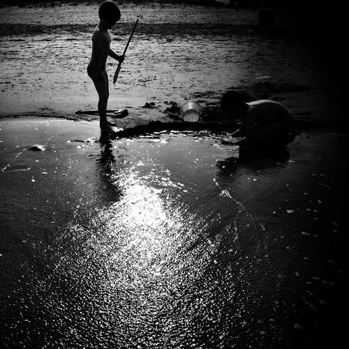 Reflection of woman in water