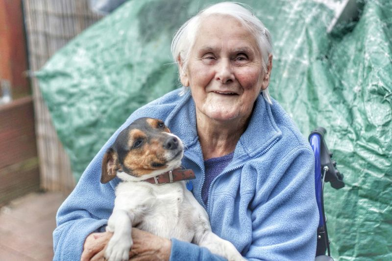 Portrait Of Senior Woman Holding Pet Dog