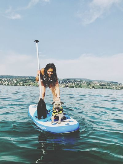 Water Sea Leisure Activity Real People Lifestyles Cloud - Sky Nautical Vessel One Person Sky Smiling Day Mode Of Transport Outdoors Nature Enjoying Life Dog Happiness Fun Holding ❤ Love Without Boundaries Standuppaddle