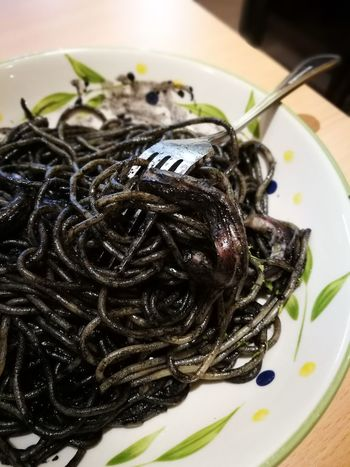 Squid Ink Pasta Squid Ink Indoors  Food Freshness Ready-to-eat Close-up No People Plate Healthy Eating Pasta Black Pasta Forks Forks, Knives, And Spoons Noodles Italian Food Food And Drink The Week On EyeEm Cooked Savory Food Serving Size Gourmet High Angle View Food Stories