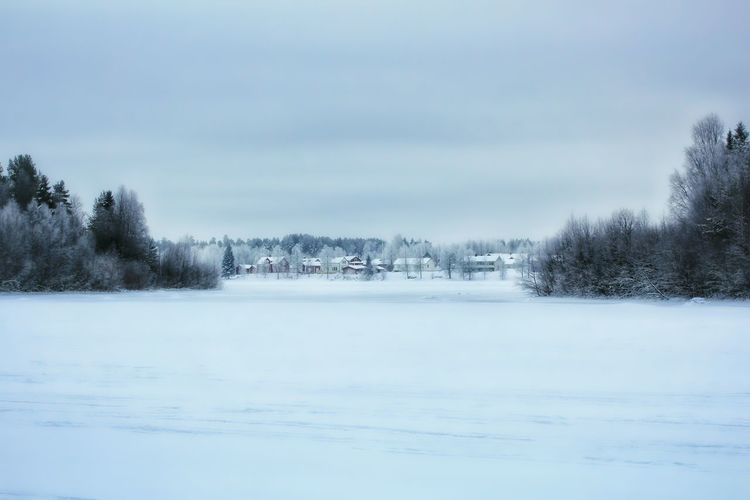 Scenic view of snowy field against cloudy sky