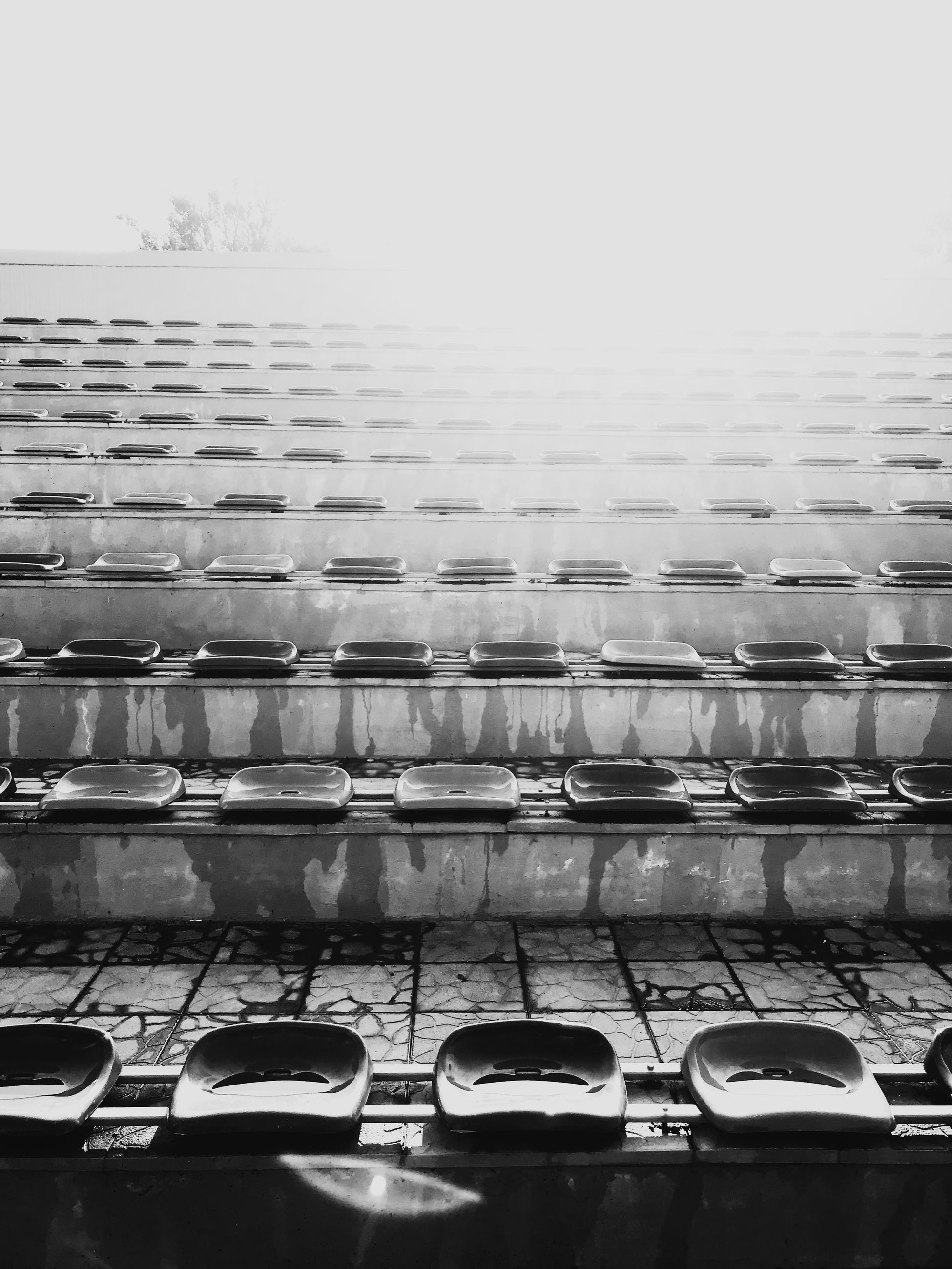 no people, side by side, in a row, car, indoors, absence, motor vehicle, arrangement, mode of transportation, reflection, glass - material, order, seat, water, still life, nature, large group of objects, chair, transportation, rain