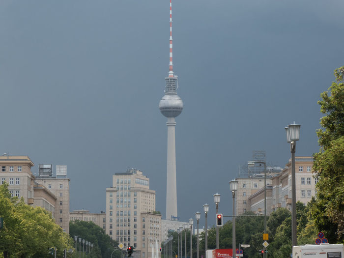 Berlin Fernsehturm, television tower in Alexanderplatz, viewed from Karl -Marx-Strasse, against cloudy sky Fernsehturm Fernsehturm Berlin  TV Tower Architecture Building Building Exterior Built Structure City Cityscape Communication East Berlin Fernsehturm / Tv Tower No People Office Building Exterior Outdoors Sky Skyscraper Spire  Tall - High Television Tower Tourism Tower Travel Travel Destinations Tv Tower Berlin