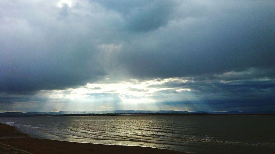 Burnham On Sea United Kingdom Quantox Hills Sun Rays Through The Clouds Sea And Sky Sandy Beach