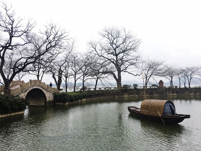 Taihu lake in Wuxi china. The beautiful view is silence but says long and old stories. Water Tree Nautical Vessel Nature Sky Architecture
