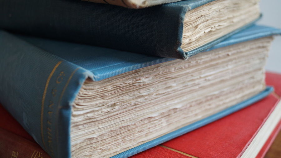 Close-up of stacked hardcover books