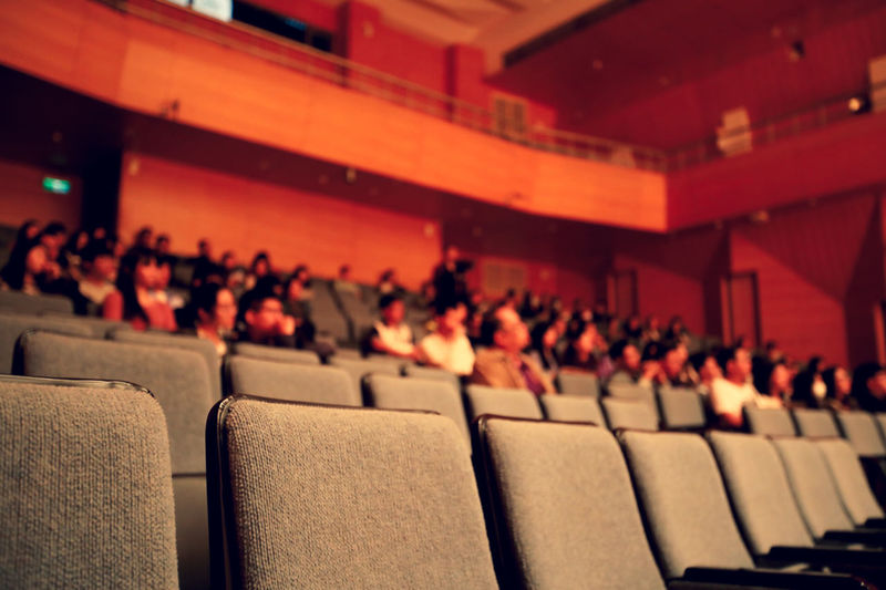 Low angle view of people in auditorium