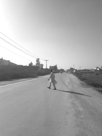 boy crossing road Road Black And White Boy One Person Only Fields And Sky Electric Poles