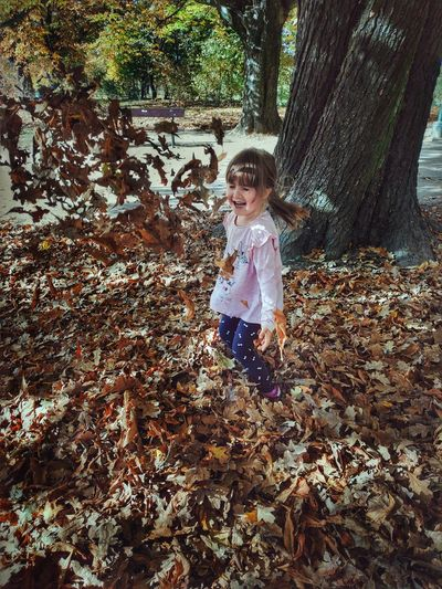 Full Length Of Girl With Autumn Leaves