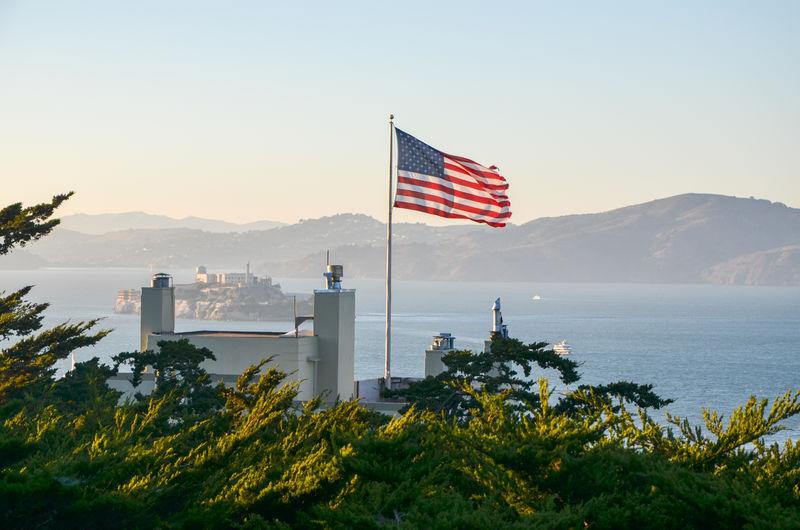 Alcatraz Alcatraz Island Beauty In Nature California Clear Sky Day Flag Flag Pole Freedom Mountain Nature No People Outdoors Patriotism San Francisco Sky Stars And Stripes Striped Tree United States