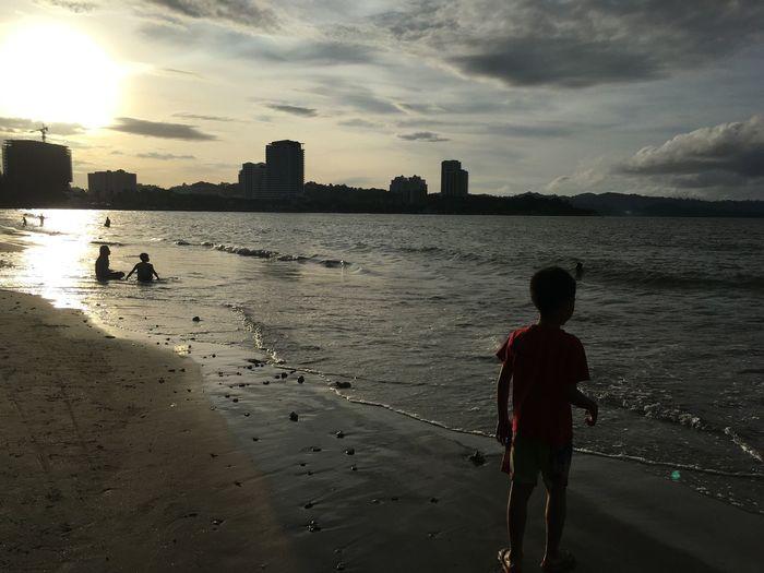 Enjoying the sunset at the beach Beach Sandy Beach Sunshine Sunset Pucnic Having Fun Playing Under The Sun Running Fun Picnic Vacation Holiday Leisure My Son Sun Landscape