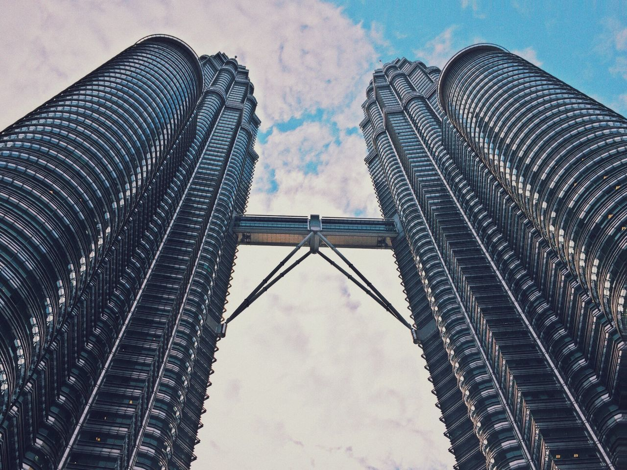 architecture, built structure, building exterior, low angle view, skyscraper, sky, tall - high, modern, city, tower, office building, cloud - sky, capital cities, famous place, travel destinations, international landmark, building, day, reflection, cloudy
