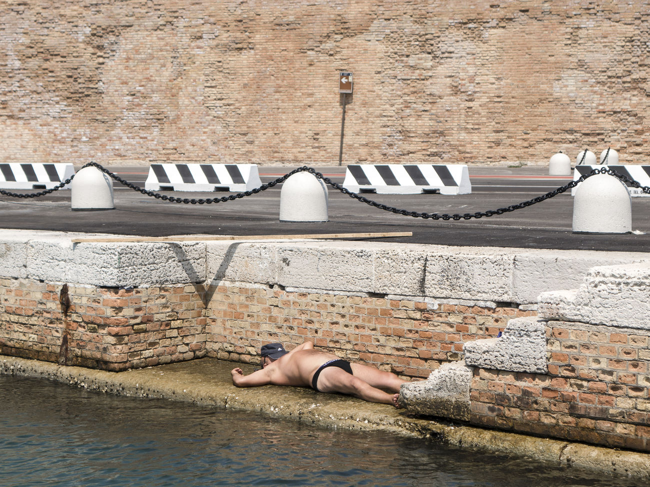 one person, lying down, real people, day, architecture