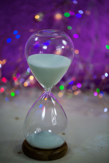 Sylvester; Party; Progress; Sand; Season; New; January; Happy-new-year; Holiday; Hourglass; Invitation; Shape; Start; Welcome; Waiting; Winter; Wishing; Year; Typography; Time; Time-line; Timer; Turn; Happy; Greeting; Celebration; Card; Christmas; Concept Close-up Focus On Foreground Hourglass Indoors  Night No People Sand Table Time