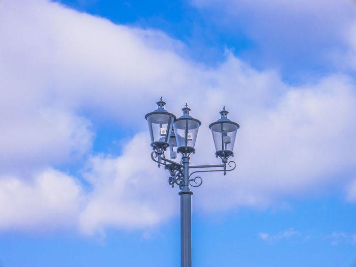 EyeEm Best Shots EyeEm Selects EyeEm Gallery EyeEmNewHere Blue Cloud - Sky Day Electricity  Eye4photography  Gas Light Lighting Equipment Low Angle View No People Outdoors Sky Street Lamp Street Light