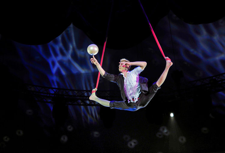 Russia, Moscow. the Nikulin circus, trapeze Adult Adults Only Black Background Circus Full Length Indoors  Mid-air Moscow Night One Person One Woman Only Only Women People Russia Russian Circus The Nikulin Circus Trapeze Trapeze Artist