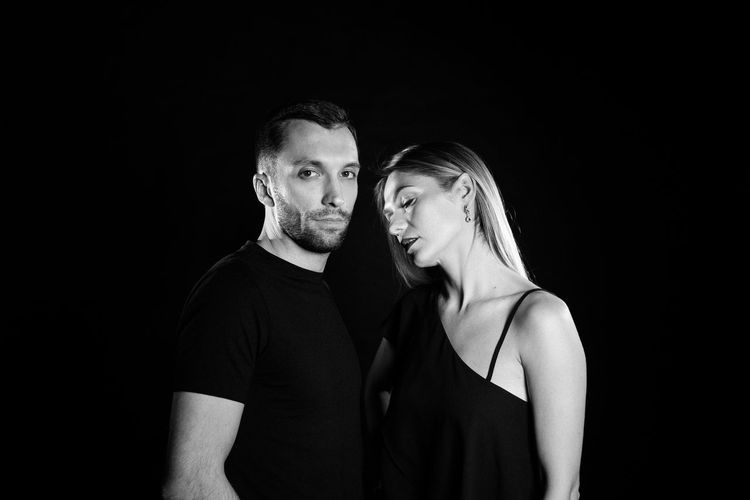 Adult Beard Black And White Black Background Couple - Relationship Facial Hair Heterosexual Couple Indoors  Men People Portrait Studio Shot Togetherness Two People Women Young Adult Young Couple Young Men Young Women