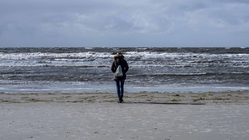 Beach Beauty In Nature Full Length Horizon Horizon Over Water Land Leisure Activity Lifestyles Motion One Person Outdoors Real People Rear View Scenics - Nature Sea Sky Standing Water Wave