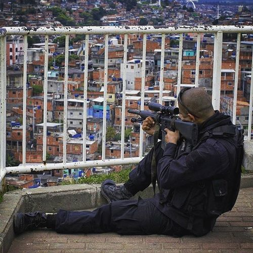 Photo 2 Civil war between police and drug dealers, does the resident of Slums in Rio de Janeiro hostages of urban violence. . Photo: Ale Silva - Foco Fixo © @focofixo_alesilva Photooftheday Photo Art Everydayusa Slums Streetphotography UrbanART Composition Everydaybrasil Capture Instalike Moment Focofixo Everydaylatinoameria Instacool Canon Instago Canon70d Canon_official Alesilva