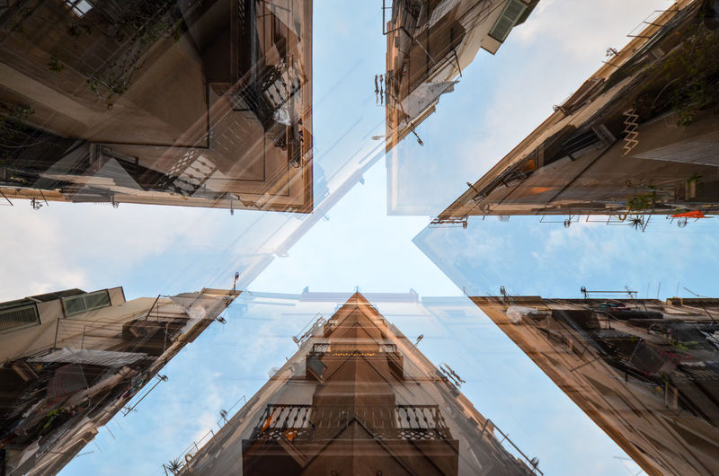 Double exposure of buildings against sky