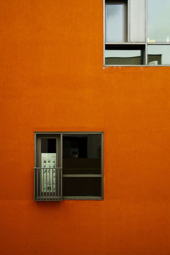 Window on orange wall of building