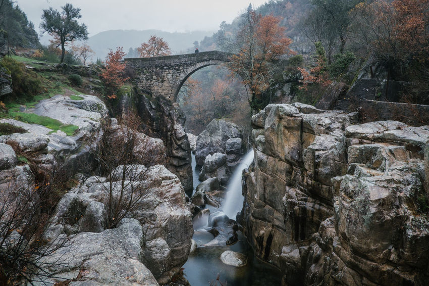 National Park Peneda Geres An Eye For Travel Business Stories Castle EyeEmNewHere FUJIFILM X-T2 Kornspeicher Lindoso Misarela Bridge National Park Nature Peneda-Gerês National Park Ponte De Misarela Portugal Shades Of Winter Architecture Beauty In Nature Bridge Bridge - Man Made Structure Built Structure Connection Day Espigueiros Espigueiros Do Lindoso Explore Footbridge Fujifilm Long Exposure Motion Nature No People Outdoors River Rock - Object Scenics Sky Tree Water Waterfall