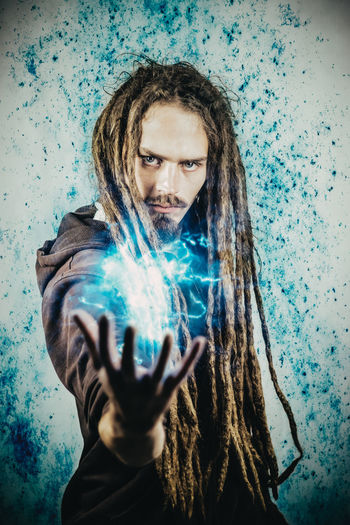 Magical Wizard Adult Blue Brown Hair Dreadhead Dreadlocks Dreads Fantastic Fantasy Fantasy Photography Flash Futuristic Holding Human Hand Illuminated Indoors  Magic Men Mystery One Man Only One Person People Real People Young Adult The Modern Professional