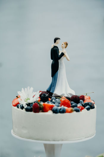 Bride and groom on top of the wedding cake. Photos taken during a wedding in Copenhagen, Denmark. Bride Groom Wedding Wedding Photography Wedding Ceremony Wedding Day Wedding Cake Cutting Indoors  Celebrating Love Newlyweds Real Wedding Wedding Cake Figurine Food Food And Drink Sweet Food Cake Sweet Fruit Baked Freshness Dessert Celebration Life Events Newlywed Indulgence Human Representation Healthy Eating Temptation