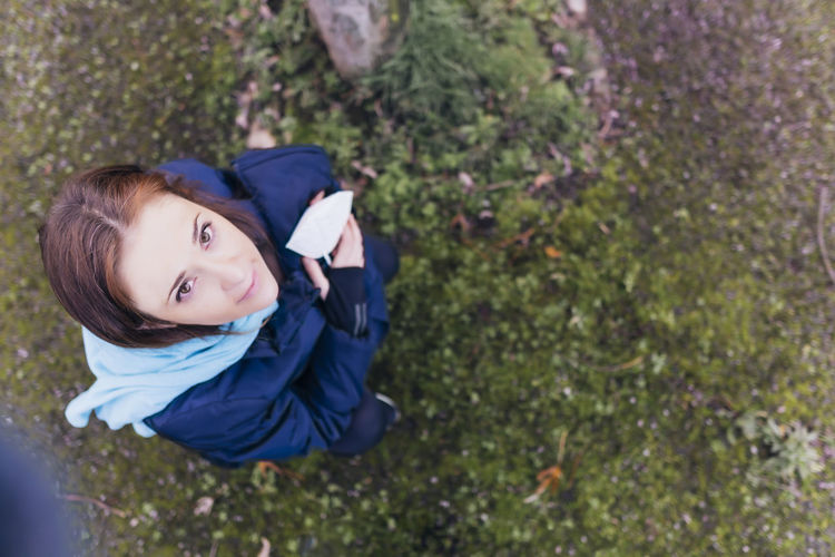 High angle portrait of woman standing on grass