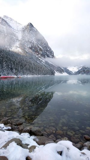 snow at every angle Mirrored Waters Water Snow Cold Temperature Winter Mountain Snowing Frozen Sky Landscape Frozen Water Frost Glacier Foggy Frozen Lake Snowcapped Mountain