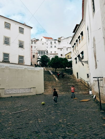 Children Football Old Town Portugal Children Playing City Group Of People Lifestyles Lisbon People Real People Residential District Street Street Photography Streetphotography