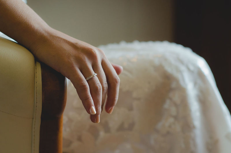 Close-up of bride showing ring in hand
