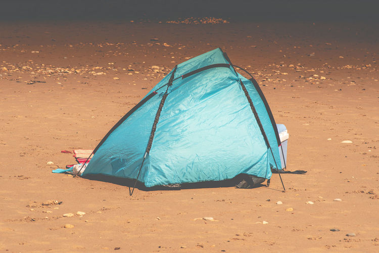 Tent on shore at beach