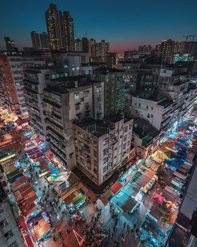 High angle view of illuminated buildings in city at night, sham shui po, hong kong.