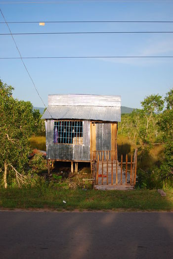 Architecture Blue Building Exterior Built Structure Clear Sky Day Empty Exterior Growth Hut Outdoors Phu Quoc Island Phu Quoc,Vietnam Phuquoc Remote Road Roadside Sky Solitude Tranquil Scene Tranquility Tree Vietnam Vietnamese Worn Out
